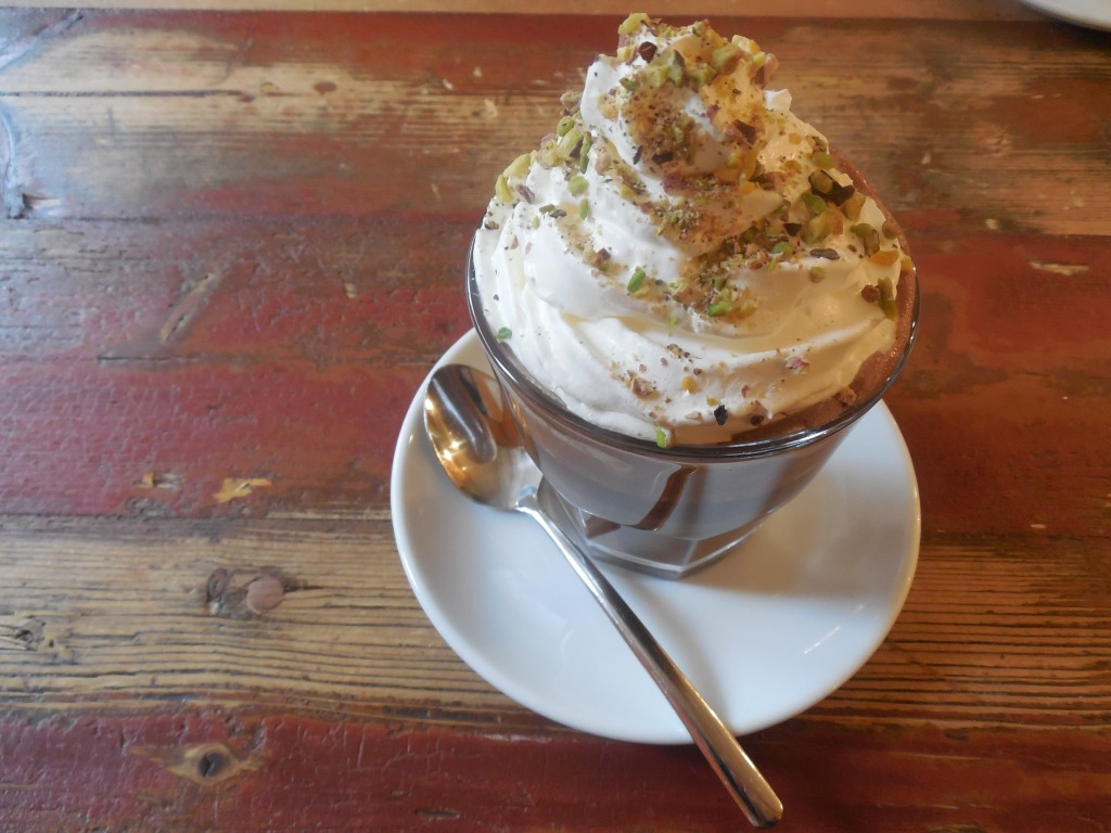 This is a photo of the best cup of hot chocolate in history. (And I know what you're thinking: are those pistachios on top of the whipped cream? And the answer is: yes. They are pistachios and they are pure brilliance.)